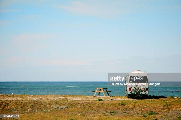 vintage campervan on a beach - marlborough new zealand stock pictures, royalty-free photos & images