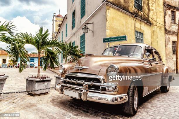 vintage car at historic square in Camagüey in Cuba