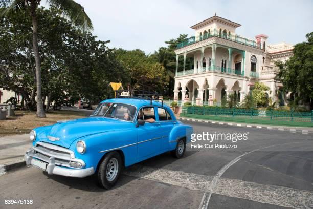 Vintage car at street of Cienfuegos in Cienfuegos province of Cuba