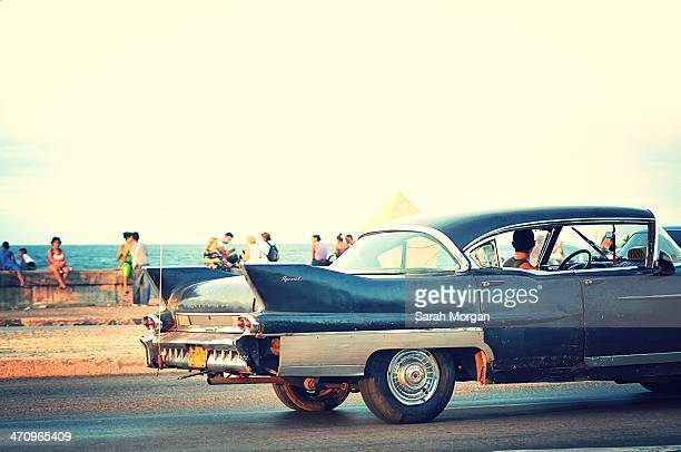 CONTENT] Vintage car cruising along the Malecon in Havana Cuba Cuban people gather to socialise along the Malecon seafront in Havana particularly on...