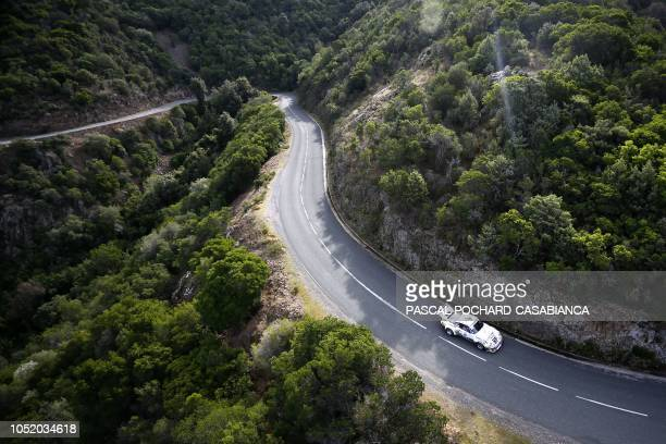 TOPSHOT Vintage car drives between Galeria and PortoVeccio during the Tour de Corse Historique 2018 on October 12 2018 on the French Mediterranean...