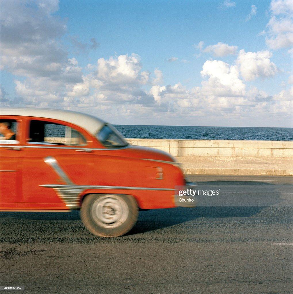 Vintage car driving along Malecon, Havana, Cuba : Stock Photo