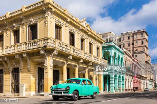 vintage car driving in front of colonial buildings, havana, cuba - ハバナ ストックフォトと画像