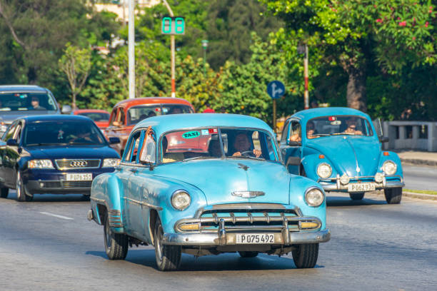 Vintage Car Driving in Havana, Cuba