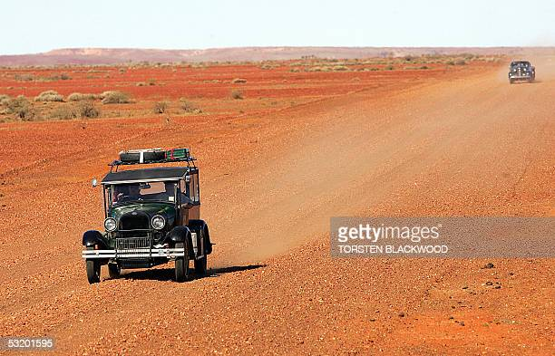 Vintage car enthusiast George Rae powers his 1928 Ford A ahead of Gary Miles' 1938 Chevrolet sedan on an outback track near the town of Oodnadatta on...