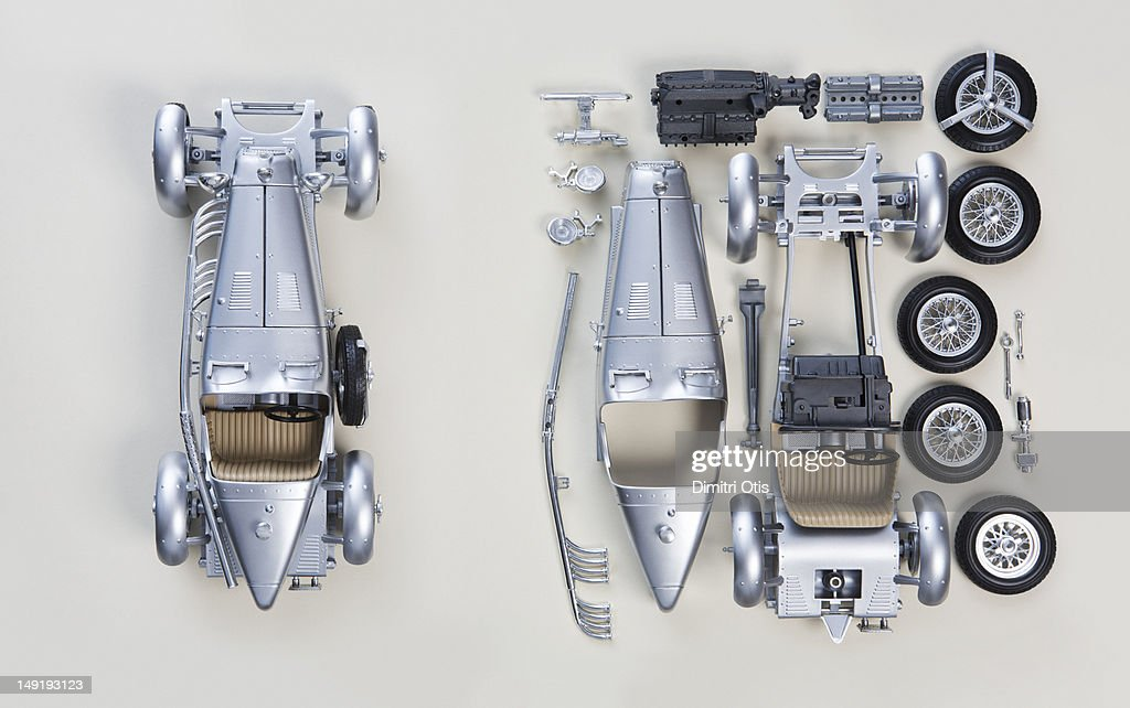 Vintage car from above, assembled and in pieces : Stock Photo