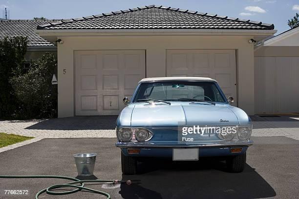 Vintage Car in Driveway