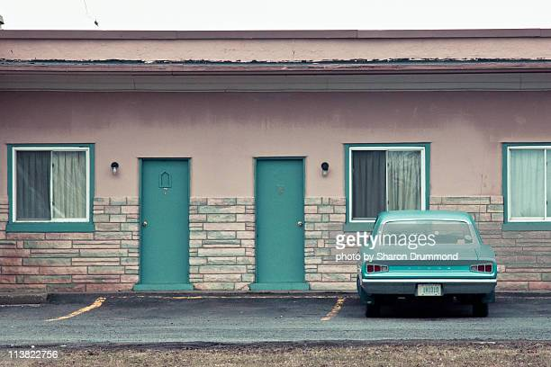vintage car in front of motel - motel stock photos and pictures