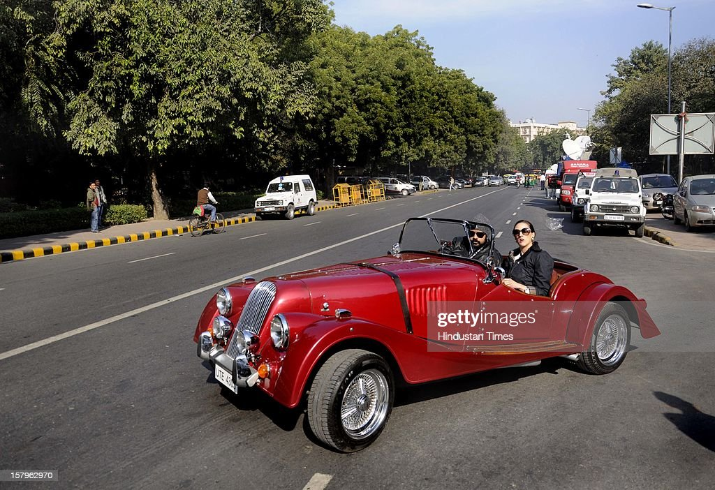 A vintage car is driven out of the Constitution Club of India on to the streets during the JK Tyre Constitution Club of India Parliamentarian Car Rally 2012 held at Constitution Club, Rafi Marg on December 8, 2012 in New Delhi, India.