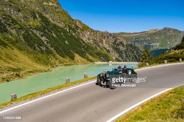 Vintage car Lagonda M 45R Le Mans driving past a lake on Silvretta Hochalpenstrasse during the Arlberg Classic Car Rally.