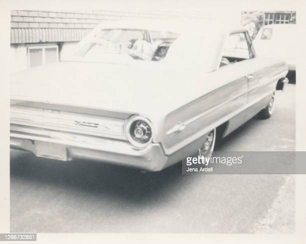 vintage car parked in driveway, 1960s photograph - 1961 stock pictures, royalty-free photos & images