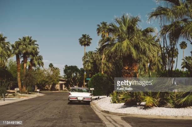 vintage car parked on suburban road, palm springs, california, usa - palm springs stock-fotos und bilder