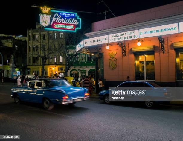 vintage car passing  next to floridita bar in old havana - ernest hemingway stock pictures, royalty-free photos & images