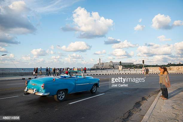 Vintage car rounding the bend in Havana, Cuba