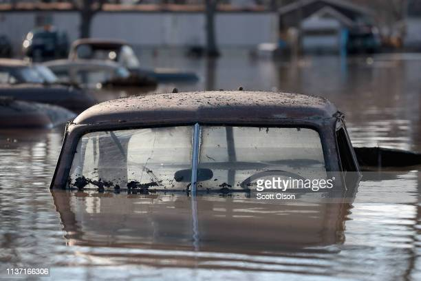 A vintage car sits in flood water on March 20 2019 in Hamburg Iowa Although flood water in the town has started to recede many homes and businesses...