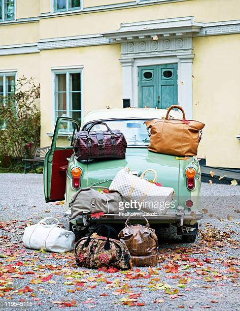 Vintage car with lots of luggage