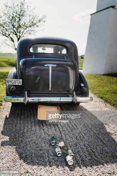 Vintage car with newlywed sign