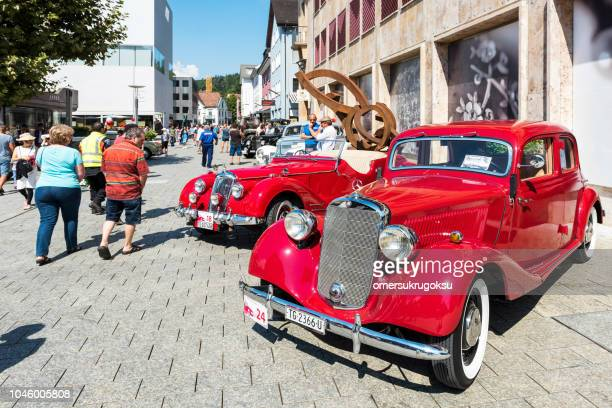 vintage cars at the traditional vaduz outdoor fair in liechtenstein - concours stock photos and pictures