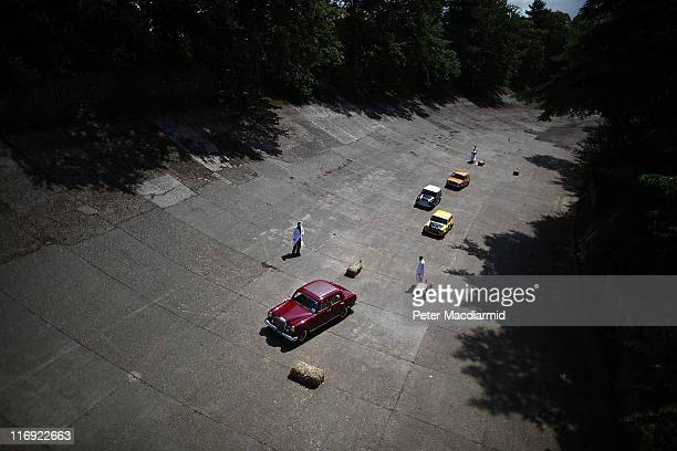 Vintage cars compete in a driving test on the banked race track at The Brooklands Double Twelve Motorsport Festival on June 18 2011 in Weybridge...