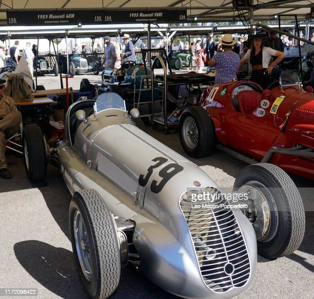 Vintage cars from the 1930's to the 1950's in the paddock on Day Three of the Goodwood Revival Festival, celebrating the cars and aircraft of decades...