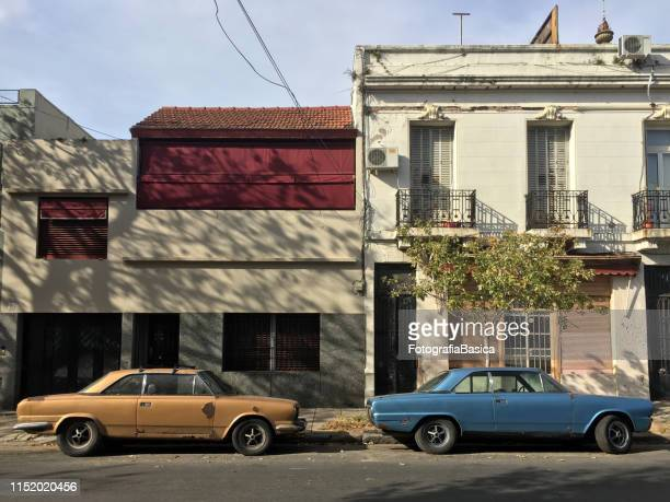 vintage cars parked in the street - 1970s muscle cars stock pictures, royalty-free photos & images