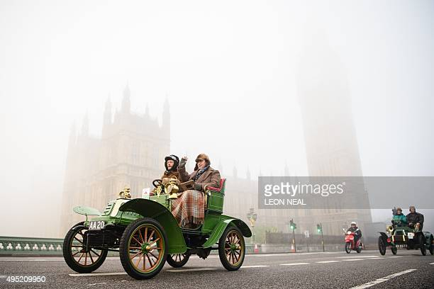 Vintage cars pass the Houses of Parliament in Westminster shortly after beginning the 119th 'Veteran Car Run' from Hyde Park in London to Brighton in...