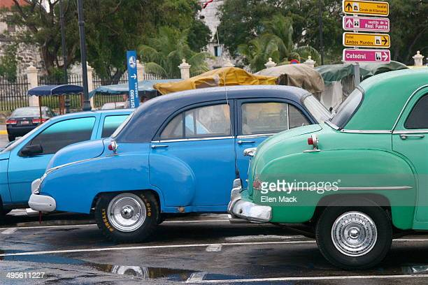 Vintage cars, such as these Chevrolets from the early 1950's, are seen throughout Cuba, as in this Havana parking lot.