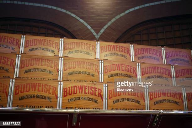 Vintage cases of beer are seen in the Clydesdale barn at the AnheuserBusch InBev NV Budweiser brewery in St Louis Missouri US on Tuesday Oct 24 2017...