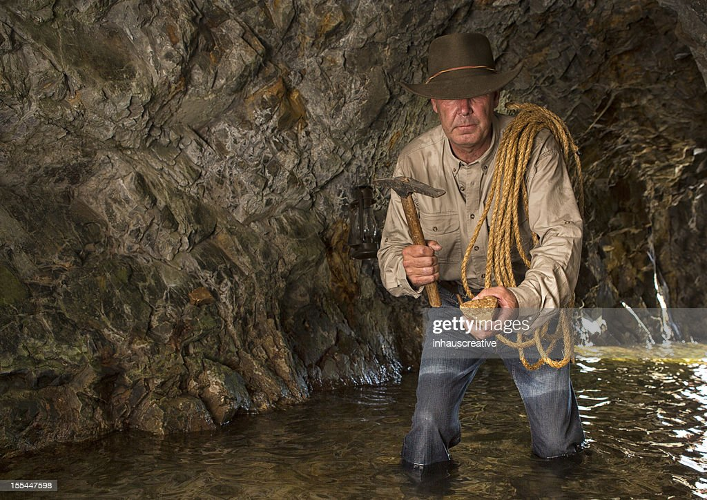 Vintage Cave Explorer Gold Mining : Stock Photo