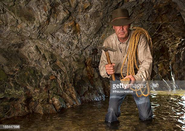 vintage cave explorer gold mining - gold rush stock photos and pictures