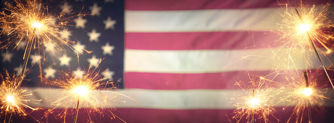 Vintage Celebration With Sparklers And Defocused American Flag - 4th Of July 1157746516