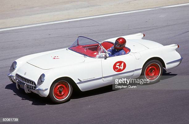 A vintage Chevrolet Corvette drives on the track at Laguna Seca Raceway during the Monterey Historic Automobile Races in August of 1991 in Monterey...