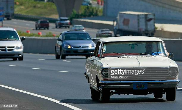 Vintage Chevrolet travels over the Woodrow Wilson Bridge on September 4, 2009 in National Harbor, Maryland. The American Automobile Association is...