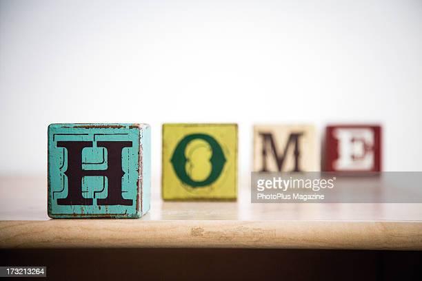Vintage children's alphabet blocks spelling out the word HOME taken on December 3 2012