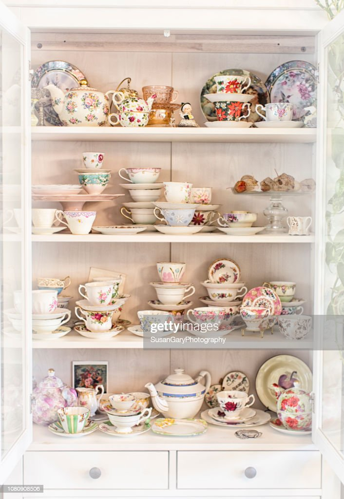 Vintage China Cabinet With Antique Tea Cup Collection High Res Stock Photo Getty Images