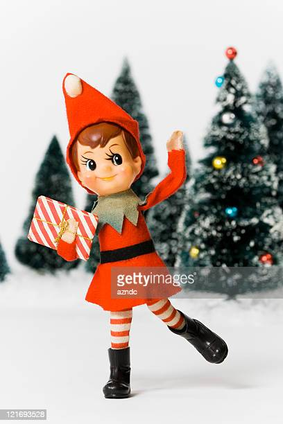 Vintage Christmas elf and miniature Christmas trees