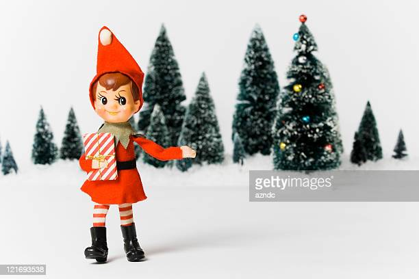 Vintage Christmas with toy elf and gift