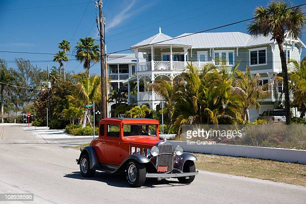 Vintage classic automobile Chevrolet modelled and luxury homes at vacation resort of Anna Maria Island Florida USA