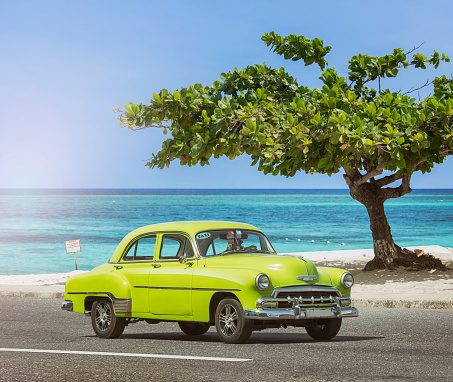 Vintage classic green american oldtimer car near Havana Cuba at beach - gettyimageskorea
