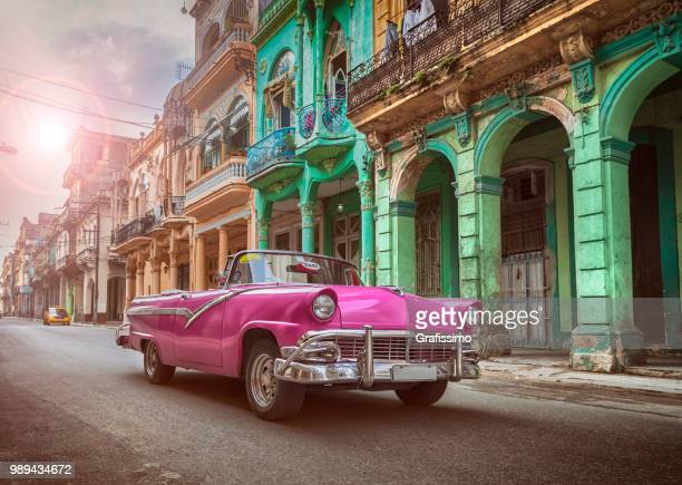 vintage classic pink american oldtimer convertible in old town of havana cuba - vintage car stock pictures, royalty-free photos & images