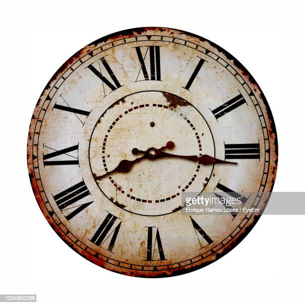 vintage clock against white background - clock stock pictures, royalty-free photos & images