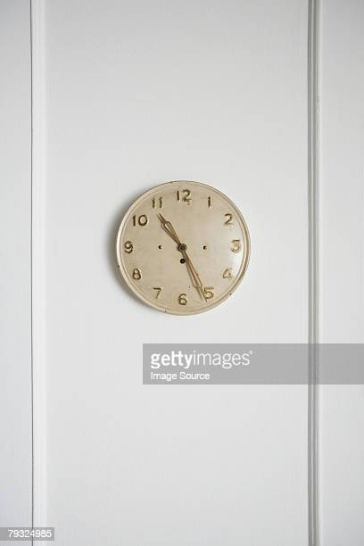 Vintage clock on a white wall