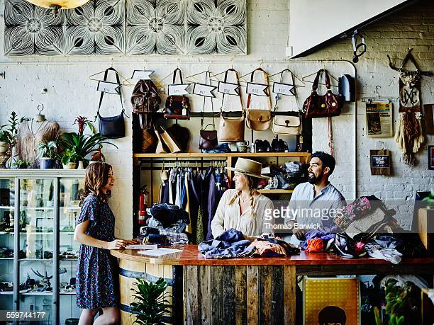 Vintage clothing store owners behind counter