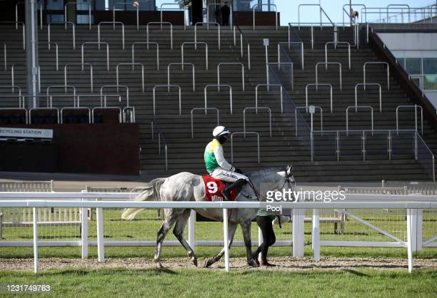 Vintage Clouds ridden by Ryan Mania in front of empty stands after winning the Ultima Handicap Chase during day one of the Cheltenham Festival at...
