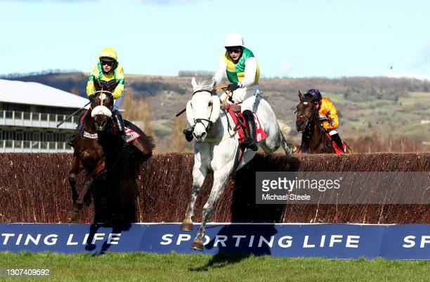 Vintage Clouds ridden by Ryan Mania jumps the last to beat Happygolucky ridden by David Bass in the Ultima Handicap Chase on Day One of the...