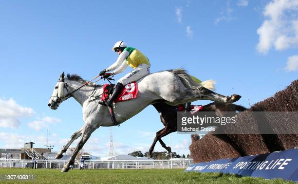 Vintage Clouds ridden by Ryan Mania jumps the last to win the Ultima Handicap Chase on Day One of the Cheltenham Festival at Cheltenham Racecourse on...
