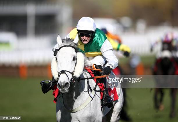 Vintage Clouds ridden by Ryan Mania on their way to winning the Ultima Handicap Chase during day one of the Cheltenham Festival at Cheltenham...