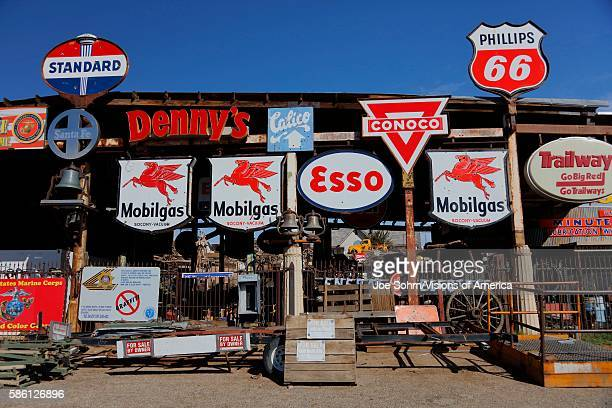 Vintage collection of Americana gas station road signs outside Barstow on historic Route 58 CA