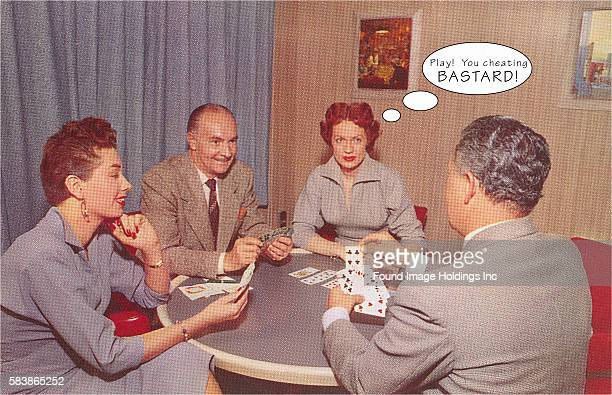 Vintage color photograph of two couples in dresses and suits sitting around a card table smilingly playing a hand while the thought bubble above one...