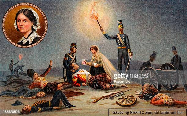 A vintage colour illustration of Florence Nightingale the Lady with the Lamp helping the wounded on a battlefield during the Crimean War circa 1854